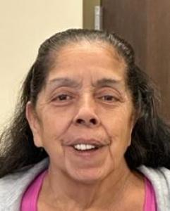 Santa Martinez Hassett a registered Sexual Offender or Predator of Florida